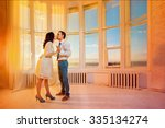 beautiful young couple is... | Shutterstock . vector #335134274