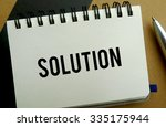 Solution memo written on a notebook with pen - stock photo
