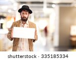 sad homeless man with placard | Shutterstock . vector #335185334