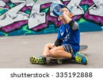 Young Boy On Skateboard Taking...
