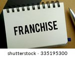 Franchise memo written on a notebook with pen - stock photo