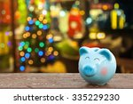 piggy bank with christmas... | Shutterstock . vector #335229230