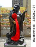 Small photo of Hong Kong, China - October 3, 2015: Chinese Zodiac Bronze Dragon Stature at Sik Sik Yuen Wong Tai Sin Temple