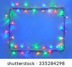 christmas lights frame on blue... | Shutterstock . vector #335284298