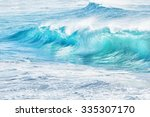 turquoise waves at sandy beach  ... | Shutterstock . vector #335307170