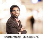 happy businessman proud pose | Shutterstock . vector #335308976