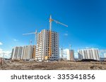 hoisting cranes and building... | Shutterstock . vector #335341856