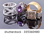 Small photo of Gold and silver jewelry: the Church's signet, wedding rings and carved ring with alexandrite