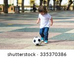 Child Playing Football On A...