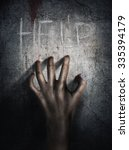 horror scene. hand on wall... | Shutterstock . vector #335394179