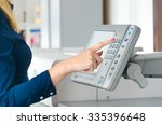 one finger pressing a print... | Shutterstock . vector #335396648