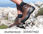 walking on the rocks of a... | Shutterstock . vector #335407463