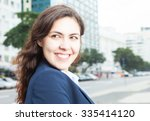businesswoman in the city... | Shutterstock . vector #335414120