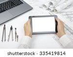 architect working on blueprint. ... | Shutterstock . vector #335419814