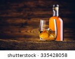 whiskey glass and bottle on the ... | Shutterstock . vector #335428058
