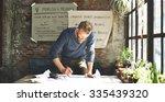 man working determine workspace ... | Shutterstock . vector #335439320