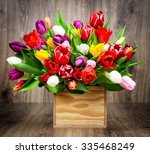tulips in the box on wooden... | Shutterstock . vector #335468249
