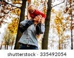 mother and daughter having fun... | Shutterstock . vector #335492054