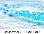 turquoise waves at sandy beach  ... | Shutterstock . vector #335548580