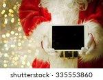 santa claus holding tablet | Shutterstock . vector #335553860
