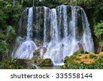 Постер, плакат: Waterfall in a lush