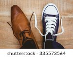 view of two different shoes on... | Shutterstock . vector #335573564