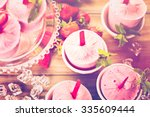homemade strawberry popsicles... | Shutterstock . vector #335609444
