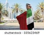 male holding uae flag outdoors | Shutterstock . vector #335623469
