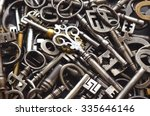 a pile of antique keys | Shutterstock . vector #335646146