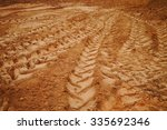 wheel tracks on dirt. | Shutterstock . vector #335692346