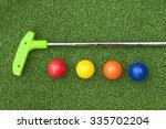 green club and balls for putt...   Shutterstock . vector #335702204