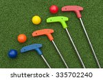four mini golf putters and... | Shutterstock . vector #335702240