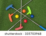 four mini golf putters and...   Shutterstock . vector #335703968