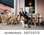 Businessman With Dog In The Cafe