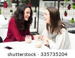 young cute women laughing while ...   Shutterstock . vector #335735204