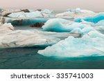 glacier melting  jokulsarlon ... | Shutterstock . vector #335741003