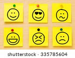 hand drawing emoticons on six... | Shutterstock . vector #335785604
