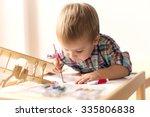 Adorable Kid Playing On His...