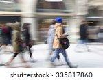 A Shopper Walking In Front Of...