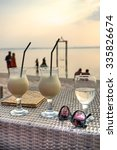 Stock photo cocktails and sunset on the beach 335826674
