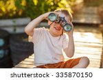 little boy looking through... | Shutterstock . vector #335870150