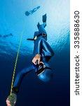 lady freediver descending along ... | Shutterstock . vector #335888630