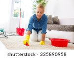 attractive housewife cleaning... | Shutterstock . vector #335890958