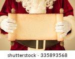 Santa Claus Holding Scroll...