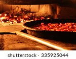 pizza with tomatoes in the oven ... | Shutterstock . vector #335925044