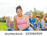 asian girl and friends sitting... | Shutterstock . vector #335984909