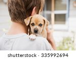 Stock photo young boy holding his new terrier mix puppy 335992694