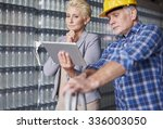 business couple in warehouse | Shutterstock . vector #336003050