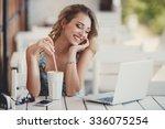 beautiful woman using laptop at ... | Shutterstock . vector #336075254