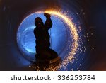 A Worker Works Inside A Pipe O...